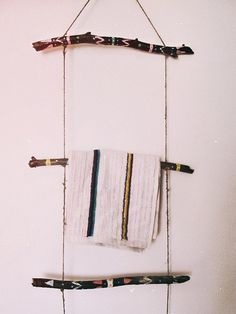 Aztec inspired wall hanging towel rack. Made of handpainted driftwood branches…