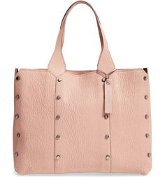 Silvertone studs add a hint of rock 'n' roll edge to this richly grained leather shopper that's a timeless and essential style in pink.