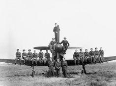 """486(NZ) Squadron at Volkel, Holland in 1945. Scanned from an orginal photograph owned by Sqn Ldr F P """"Joe"""" Kendall (4th from left sitting on stbd wing), a member of the squadron March - July 1945. The aircraft pictured is one of the squadron's own Hawker Tempest Mk Vs. DateMarch-July 1945. Source""""Joe"""" Kendall. Originally uploaded to EN Wikipedias as en:Image:486SqnVolkers1945.JPG by Johnkendall1 17 January 2007. AuthorServing member of the RAF, 1945. Qualifies as PD-BritishGov (pre 1947)."""