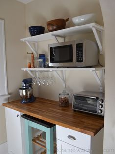 I posted about the kitchen nook two years ago, and I am now very ashamed that it took me two years to actually finish it. We finished half the nook with the kitchen renovation but the wall opposite…