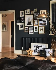 I love the look of dark wall and gold frames.