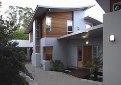 Award winning Rischbieth Houses in the ACT, designed by TT Architecture using roof and wall cladding made from COLORBOND steel and ZINCALUME steel.