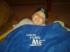 Gabe looks AWESOME with his Cancer Fears ME chemo cap and fleece blanket from his Cool Kids care package!