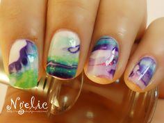 First official attempt at Watermarbling for Day Twenty: Water Marbled Nails. Here's what I used:  Jordana: White,  China Glaze: Bermuda Breakaway,  Jordana: Boy, Oh Boy,  Zoya: Apple,  Essence: Mellow Yellow,  Jordana: Tender Coral,  Water and a Cup