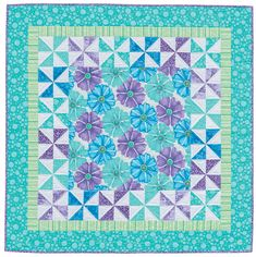 """Just can't cut that pretty fabric"" solution:  pinwheels and borders around it - cute idea from ""Simple Quilts from Me and My Sister Designs: Easy as 1, 2, 3"" (book) by Barbara Groves and Mary Jacobson, via shopmartingale    ...great pattern to show off a large print..."