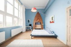 This blue bedroom exists inside of an old school, complete with vintage accents.