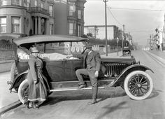 A Chalmers touring car, circa 1920, on California Street in San Francisco. Notice the hand-varnished finish of the car, and, like the Star automobile shown elsewhere on the board, it has clincher rims.