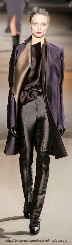 Haider Ackermann- well, I do HAVE pants like that. tight, but silk. and red. heh…