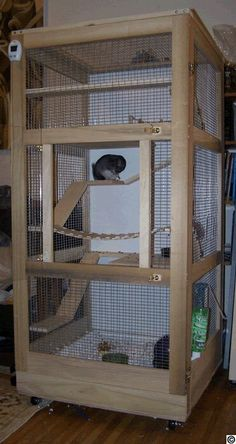 Wooden chinchilla cage- I want to diy this!!! I love the wooden suspension bridge