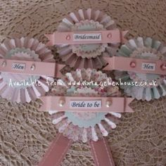 Rosette style badges with a pin fastening (can be personalised). £4.50 each.