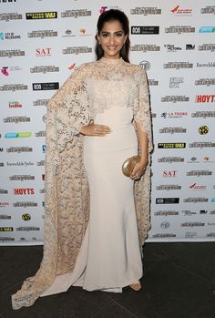 Sonam Kapoor Evening Dress - Sonam Kapoor looked very queenly in this nude Paolo Sebastian gown, boasting a floor-sweeping lace cape, at the Indian Film Festival of Melbourne Awards. Prom Dresses Two Piece, Nice Dresses, Girls Dresses, Sonam Kapoor, Black Evening Dresses, Evening Gowns, Lehenga, Mode Turban, Hijab Dress Party