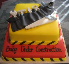 Baby Under Construction - This was a cake made for a baby shower with lots of ideas from other creative bakers on CC- the dad-to-be is in construction and the theme had tools and caution tape. Fun for mom and baby!