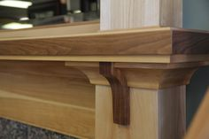 Custom Mantel in Walnut and Birch. On display in the Madison showroom.
