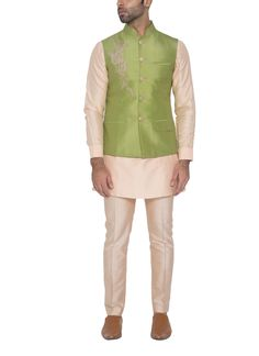 This elegant waistcoat in a pleasing green hue by WYCI is sure to become your favourite go to piece for important occasions! The lovely contrasting dori embroidered detailing on the right shoulder and matching button fastenings make this waistcoat look fabulous.  #indianclothes #indiandesignerclothes #menskurtas #menssherwanis #indiandesigners #strandofsilk #strandofsilk.com #indiangroomclothing #indianwaistcoat