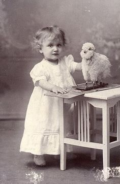Little girl and toy lamb (?)