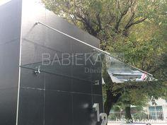 Marquesina de cristal con tensores de acero inoxidable para entrada.  www.babieka.com.mx