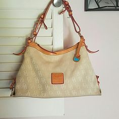 Dooney and Bourke bag. Tan fabric covers the body with camel colored straps. This bag is great for everyday  wear!!                                 $85