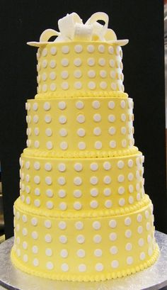 yellow w/ white polka dots.  Change to yellow and this would of so been my wife's favorite for her wedding cake.