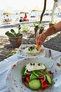 Lunch in Kamari Beach, Santorini, must try a delicious authentic greek salad!