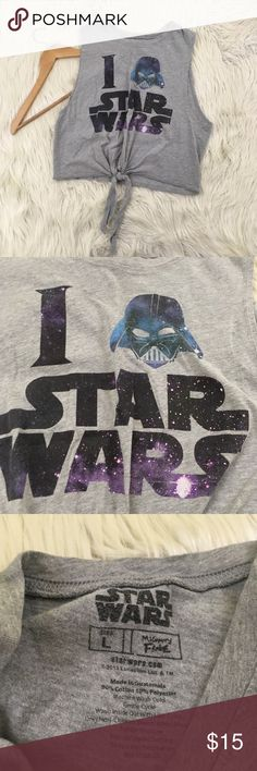 """Star Wars Darth Vader Galaxy Crop Top Womens Large Star Wars Darth Vader Galaxy crop top. Excellent condition no flaws.  Length: 18"""" Armpit to armpit; 19""""  📌NO lowball offers 📌NO modeling 📌NO trades  Come check out the rest of our closet! We have various brands and ALL different sizes! Star Wars Tops Crop Tops"""