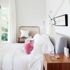 Don't you just love that pink velvet pillow on the crisp linens? (image by Donna Griffith)