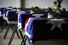 Caskets of the five fallen Australian Soldiers during the memorial service in Tarin Kot.