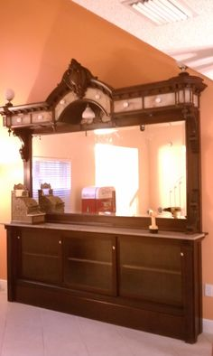 Our 1890's Ice Cream Parlor back bar. This monster stands well over 12 ft. tall at the bonnet, features genuine onyx inlays and is made of solid mahogany. Absolutely perfect piece of Americana and the centerpiece of our collection. Originally from a parlor in Brunswick, GA.