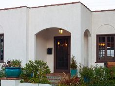 High-contrast landscapes call for high-contrast color palettes. This desert ranch stays cool with a white exterior and an accent of chocolate brown trim. The beauty of this color combo? Any accent color can be chosen for outdoor furniture and decorations. Paint colors: Cottage White and Divine Wine by Behr
