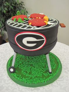 I'd really love this if it were an ALABAMA grill (cake)! 35 Impressive Cakes Shaped Like Grills For Father's Day Unique Cakes, Creative Cakes, Grooms Cake Tables, Groom Cake, Georgia Bulldogs Cake, Bbq Cake, Realistic Cakes, Fathers Day Cake, Cake Shapes