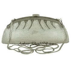 This Anthony David silver crystal evening bag has a solid metal frame that is fully covered with Swarovski crystals. Each crystal is hand set by a skilled artisan; making each design truly a work o...