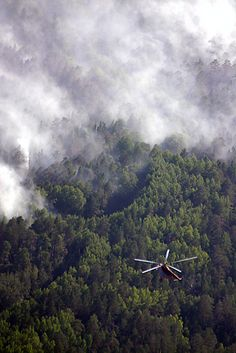 Helicopter over forest fire