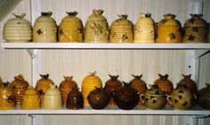 Great Collection of antique honey pots