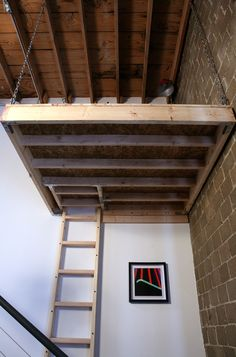 A Raised Platform With An Overhead Suspended Storage Loft