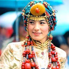 Khampa Arts Festival Tibetan fashion show - she's wearing finery from Palyul county