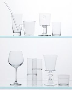 "Glassware for Every Occasion - Top row: Rosenthal ""diVino"" glass (bloomingdales.com) with Made in California ""Beautiful Bends"" glass straw; Bodum mug (macys.com); Astier de Villatte ""Alexandre"" goblet (mazehome.com); Nason Moretti ""Clear Optical"" glass (michaelcfina.com). Bottom row: Martha Stewart Collection wineglass (macys.com); Fferrone Design wine-and-water glass (aplusrstore.com); Step Telc goblet (tableartonline.com); Jasper Morrison wineglass (canoeonline.net)."