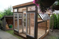 greenhouse with vintage storefront, made from reclaimed windows and reclaimed wood flooring Greenhouse Shed, Greenhouse Gardening, Window Greenhouse, Simple Greenhouse, Homemade Greenhouse, Gardening Tools, Gardening Gloves, Outdoor Rooms, Outdoor Gardens