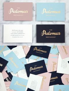 Hand Drawn Typography In Gold Foil On A Business Card For A Restaurant