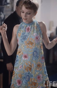 Mia Farrow, 1960's. color photo print ad movie star model fashion style vintage floral sparkle sequin shift dress mod twiggy pastel blue yellow pink kitten bow halter 60s