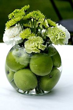 Apples are best used uncut. The large fruit helps anchor the flowers and creates a professional-looking centerpiece