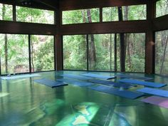 The perfect group meditation, exercise and quiet movement room. writes: Kate Taylor: Hostel in the Forest, this amazing place consists of hand-built tree houses and dome structures on ~120 acres of forest near the town of Brunswick on the Georgia coast. This photo is of yoga room a ~600 square foot hexagonal structure, with sliding glass doors all the way around. Practicing in the glass house is like practicing on the forest floor (but with a roof over your head and screens to keep away…