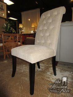 """Ashley dining chair in an oatmeal upholstery with tufted back on dark legs. Could be used as a desk chair also. 20""""wide x 26""""deep x 42""""high. At posting, we have two of these and the matching dining set."""