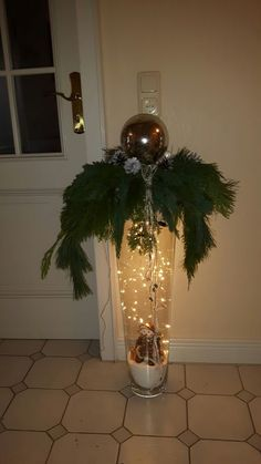 tall vase with hanging christmas balls lights I know this is the wrong color more the idea to share