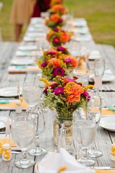farm table - purple and orange flowers in mason jars