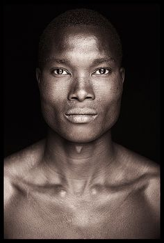 Lines that Lead to Perfection by John Kenny Photography. A beautiful Betamarribe young man with very intricate facial scarification in Benin.