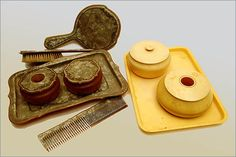 """Two vanity ensembles in 'modern' materials that included hair receivers. (at right) """"Ivoroyd"""" or """"compressed ivory"""" was patented in 1855. (at left)"""