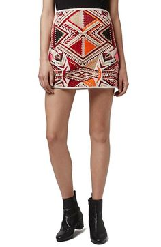 Free shipping and returns on Topshop 'Desert Traveller' Jacquard Miniskirt at Nordstrom.com. Earthy reds and sunset pinks color a geometric embroidered A-line miniskirt inspired by ancient tapestries of the Southwest.