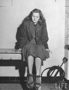 """Ilse Koch, """"The Witch of Buchenwald"""", sitting in a cell after her capture by Allied forces, April 1946 - Ralph Morse"""
