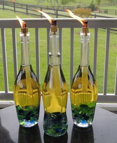 DIY Wine Bottle Tiki Torch + Five more wine bottle DIYS