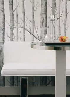 Grey and white birch wallpaper paired with modern furnishings