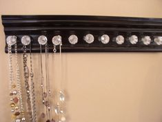 """WOW necklace holder. This jewelry organizer has 11  small acrylic  knobs on black finish 15"""" ideal individual wall jewelry storage. hanging"""